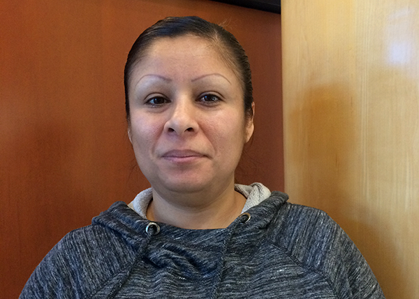 Relay janitor Guadelupe Torres was among the SEIU 49 members who testified to the Board of Commissioners.